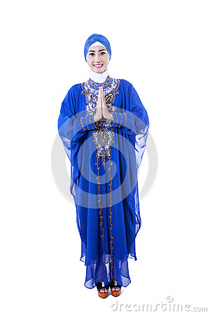 Beautiful female muslim in blue dress on white background