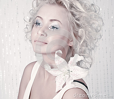 Beautiful female with original make up and flower