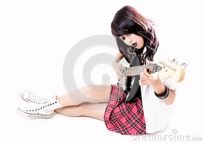 Beautiful female rocker with guitar