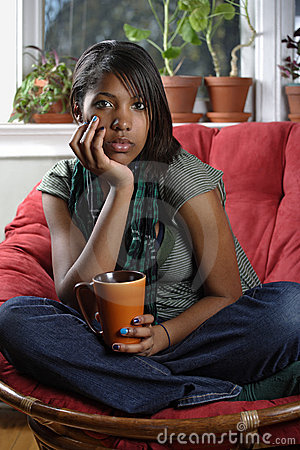 Beautiful female sitting with coffee