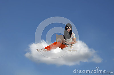 Beautiful female sitting with laptop on cloud