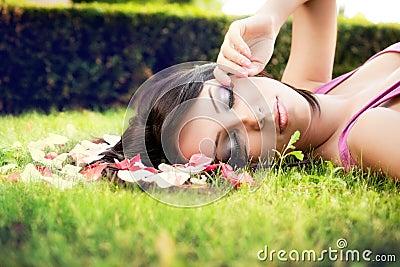 Beautiful feminine woman and flower petals