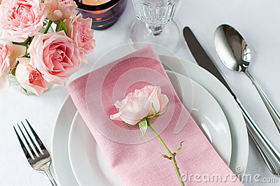 Beautiful festive table setting with roses