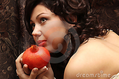 Beautiful fiancee with a pomegranate