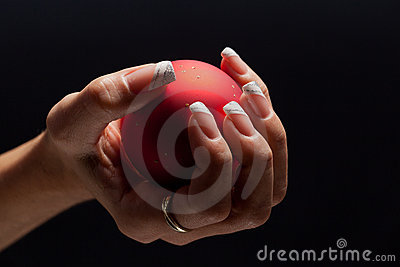 Beautiful fingernails plus decorative ball