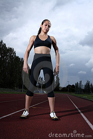Beautiful fit young woman athlete on running track