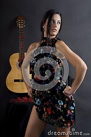 Beautiful flamenco dancer with black background
