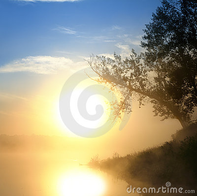 Beautiful fog sunrise on river