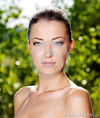 Beautiful fresh female face outdoors