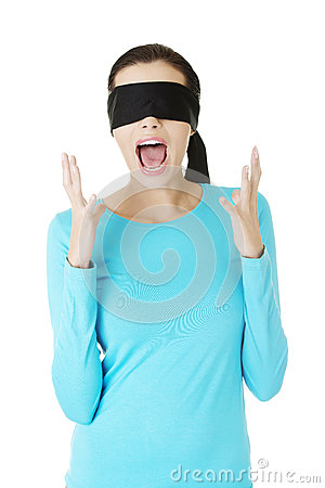 Beautiful frighten young blindfold woman screaming