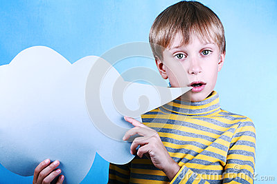 Beautiful funny blond boy holding a blank blue message cloud saying something