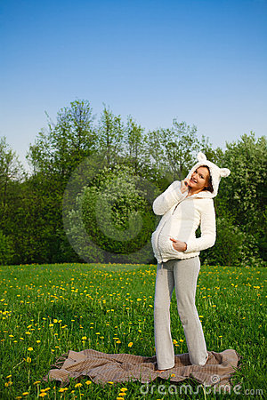 Beautiful funny pregnant woman in a suit lamb