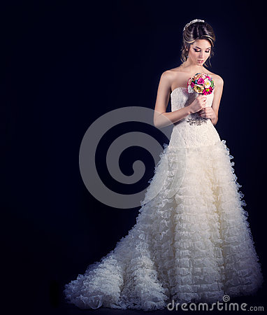 Free Beautiful Gentle Woman Happy Bride In A White Wedding Dress With A Train Cabin With A Beautiful Wedding Hairstyle With White Flowe Royalty Free Stock Photos - 51243908