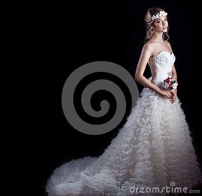 Free Beautiful Gentle Woman Happy Bride In A White Wedding Dress With A Train Cabin With A Beautiful Wedding Hairstyle With White Flowe Royalty Free Stock Photo - 51794295