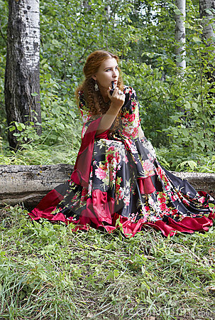 A beautiful ginger-haired girl in gipsy suit