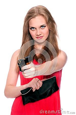 Beautiful girl aims a gun