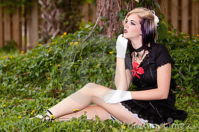 Beautiful girl with alternative style clothing