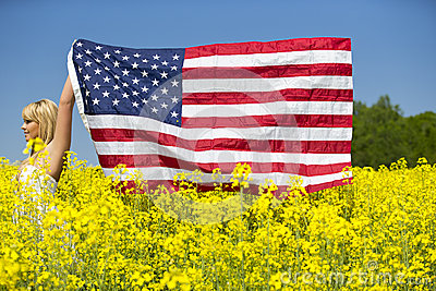 A beautiful girl with american flag in yellow field