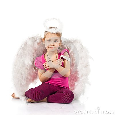 Beautiful girl in angel wings and nimbus