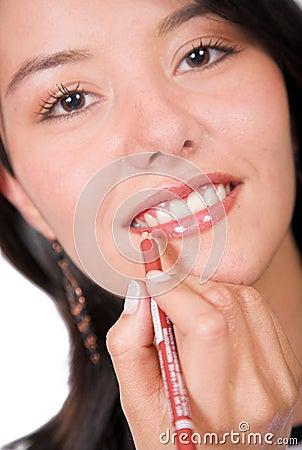 Beautiful Girl applying make up 1