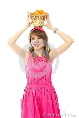 Beautiful girl with a basket full of tangerines