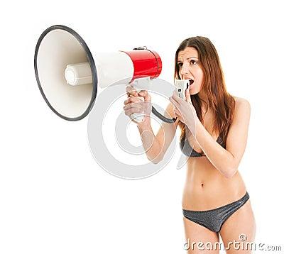 Beautiful girl in bikini shouting into megaphone