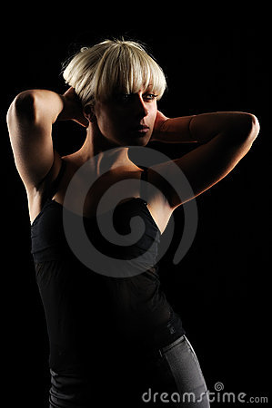Beautiful girl on black background portrait