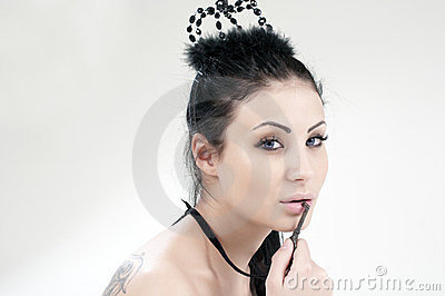 Beautiful girl with a black crown on her head