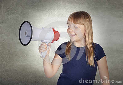 Beautiful girl with blond hair shouting on megaphone
