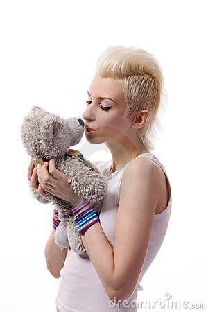 Beautiful girl with blonde hair and toy bear