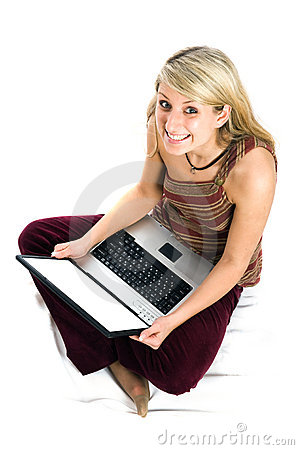 Beautiful girl with blonde hair using laptop