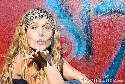 Beautiful girl blowing kiss