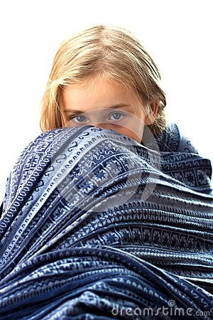 Beautiful girl in blue blanket