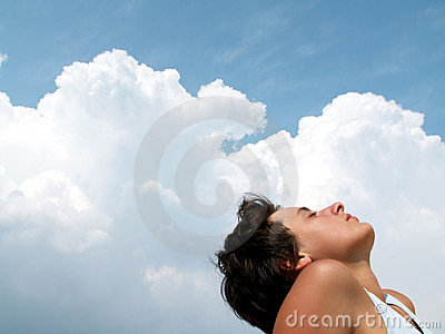Beautiful girl on blue sky