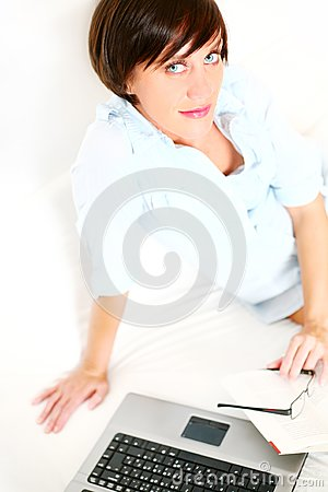 Beautiful girl with book and laptop