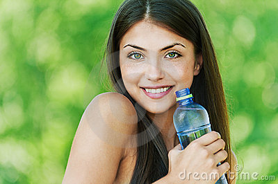 Beautiful girl with bottle of water