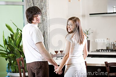 Beautiful girl and boy on kitchen