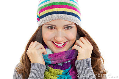 Beautiful girl in bright hat and scarf