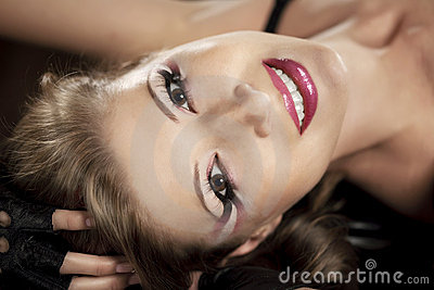 Beautiful girl with a bright luxurious makeup
