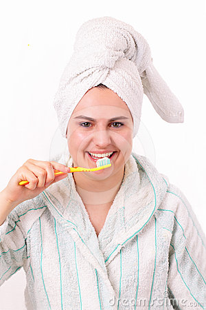 Beautiful girl brushes her teeth