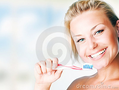 Beautiful Girl Brushing her teeth