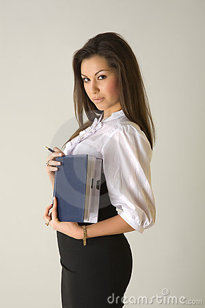 Beautiful girl in business outfit holding notebook
