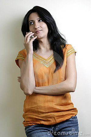 Beautiful girl busy talking on mobile phone