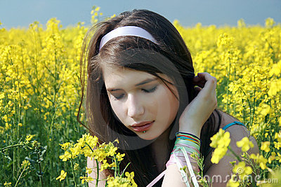 Beautiful girl at canola