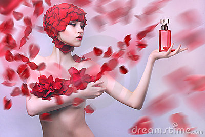 Beautiful girl with a cap of rose petals