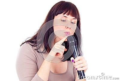 Beautiful girl checks the microphone
