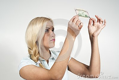 Beautiful girl checks money
