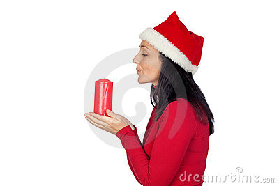 Beautiful girl with Christmas blowing a candle
