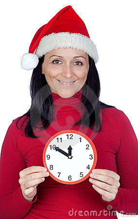 Beautiful girl with Christmas hat and a clock