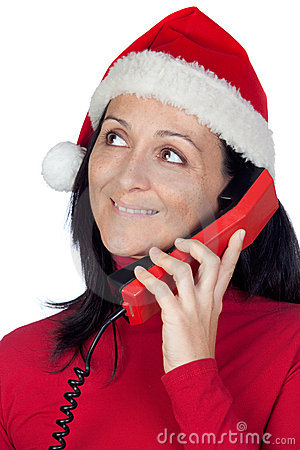 Beautiful girl with Christmas hat to phone